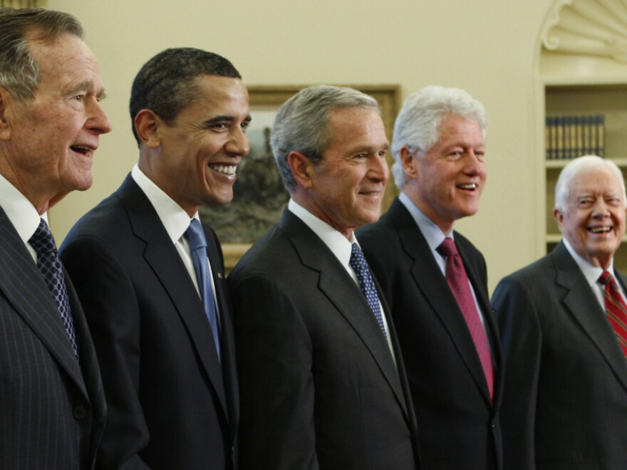 <p>Obama is surrounded by former presidents in the Oval Office in 2009. Two of his predecessors — George W. Bush and Bill Clinton — won two terms, while two others — George H.W. Bush and Jimmy Carter — left office after just one. </p>
