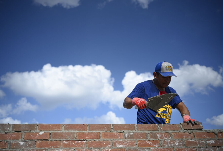 Mason Javier Chacon positions a brick during the regional Bricklayer 500 competition in Bridgeton, Missouri, on Sept. 12, 2019.