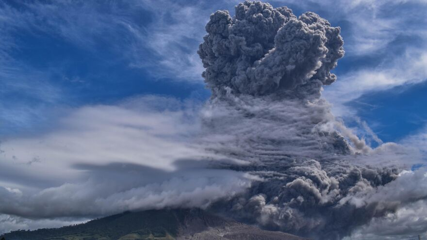 Mount Sinabung on Indonesia's Sumatra Island spews thick ash and smoke miles into the sky on Monday.