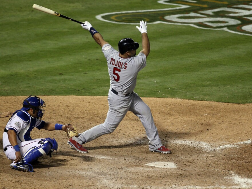 <p>Albert Pujols of the St. Louis Cardinals hits his third home run of the game — tying a World Series single-game record — Saturday night in Arlington, Texas. His team beat the Texas Rangers 16-7 to take a 2-1 lead in the series. </p>