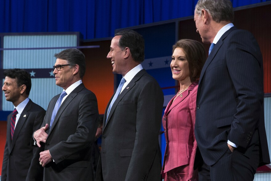 """Republican presidential candidates (left-right) Bobby Jindal, Rick Perry, Rick Santorum, Carly Fiorina and George Pataki on stage during the first """"kid's table"""" debate last month."""
