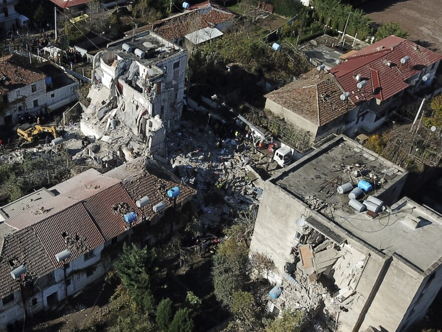 Rescuers look for survivors after a building partially collapsed in Thumane, Albania, after a powerful earthquake struck in the country's western region on Tuesday.