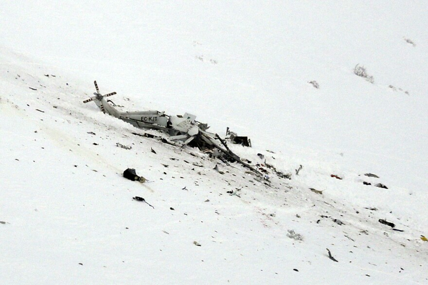 The wreckage of a helicopter lies in the snow after crashing Tuesday in the Campo Felice ski area of central Italy.