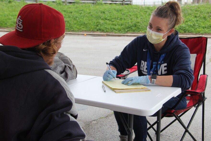 Dr. Katherine Austman, a fellow with the Addiction Recovery Centers of America, conducts a follow-up appointment with a patient living at an encampment for homeless people on May 28, 2020.