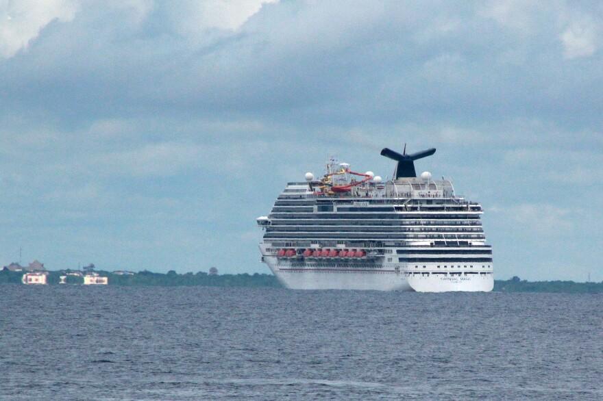 The cruise ship Carnival Magic passes near Cozumel , Mexico, on Friday.