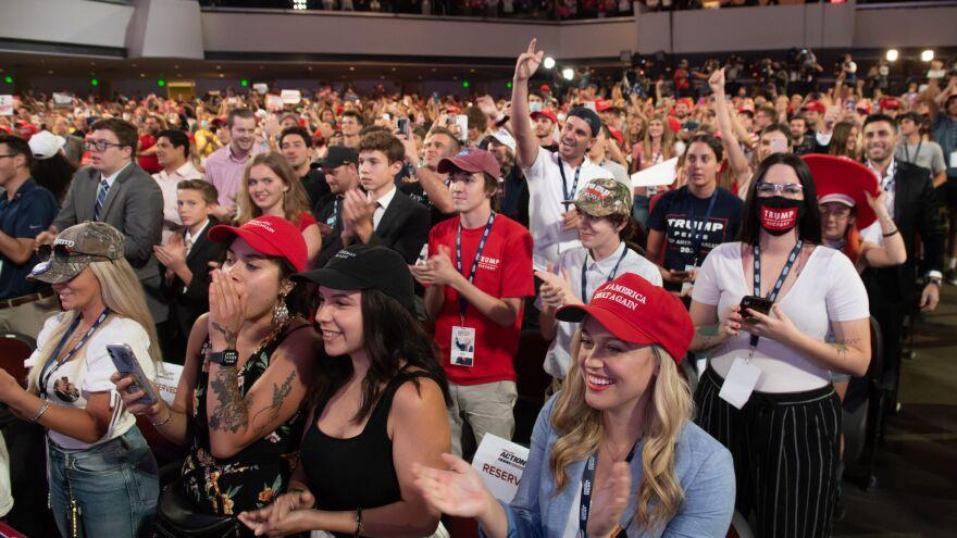 Students cheer as Trump speaks.