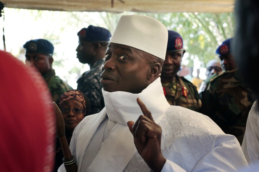 Gambia's president Yahya Jammeh shows his inked finger during voting earlier this month in Banjul, Gambia.