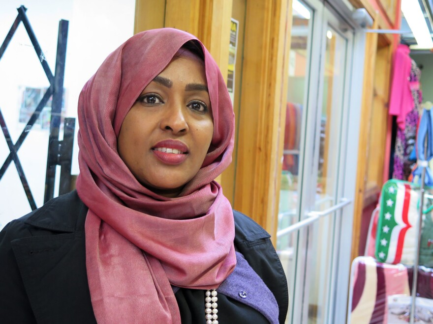 Khadra Abdulle, a resident of St. Paul, stops to shop at the Riverside Market in the Cedar-Riverside neighborhood of Minneapolis. It's the inaccurate information about a link between vaccines and autism, she says, that's keeping some well-meaning parents from getting their kids vaccinated against measles.