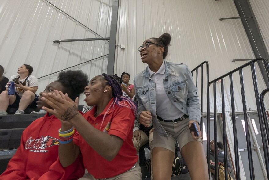 Lift for Life Academy students cheer on the high school girls' volleyball team during the first home sporting event in the school's new gym, Wednesday, Sept. 26, 2018.