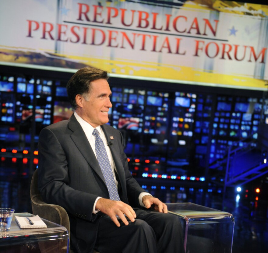 Former Massachusetts Gov. Mitt Romney appears on the Fox News program <em>Huckabee</em> on Dec. 3. The Republican presidential candidate has made a number of media appearances recently, mostly on Fox. He scarcely spoke to the media until the last week or so.