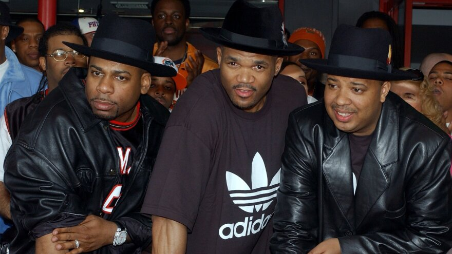 "Jason ""Jam Master Jay"" Mizell, from left, Darryl ""DMC"" McDaniels and Joseph ""DJ Run"" Simmons of the hip-hop group Run-DMC in 2002. Federal prosecutors announced charges Monday in Mizell's death, a case that has gone unsolved for nearly two decades."