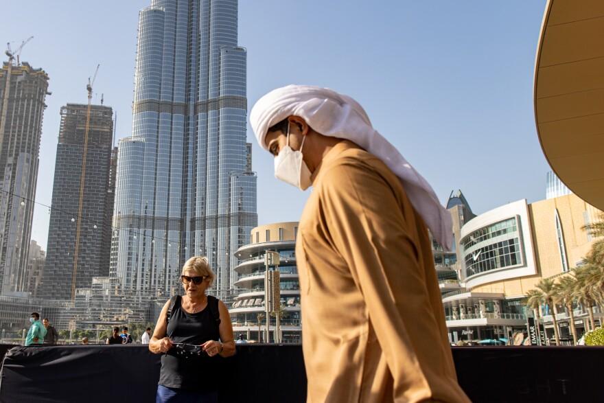 An Emirati man walks past an Israeli tourist at the Burj Khalifa, the world's tallest building, in Dubai, United Arab Emirates, last month.