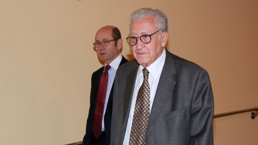 Lakhdar Brahimi, right, joint special representative for Syria, arrives at closed door consultations regarding the situation in Syria at the Security Council at United Nations headquarters on Monday.