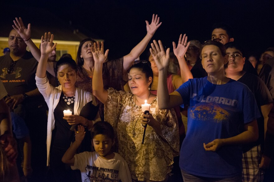 Residents of Sutherland Springs, Texas, gathered at the town's post office for a vigil on Sunday night.