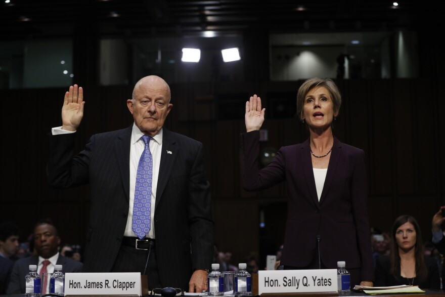 Former acting Attorney General Sally Yates and former National Intelligence Director James Clapper are sworn-in on Capitol Hill in Washington. (Pablo Martinez Monsivais/AP)