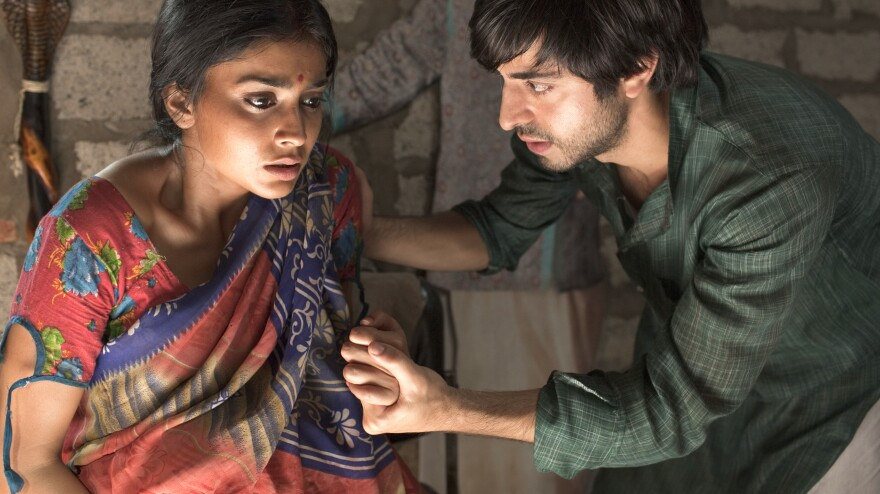Parvati and Saleem (Shriya Saran and Satya Bhabha), born in tandem at the birth of independent India, are at the center of Salman Rushdie's novel <em>Midnight's Children. </em>Thirty years after the book's publication,<em> </em>filmmaker Deepa Mehta has committed the story to the big screen.