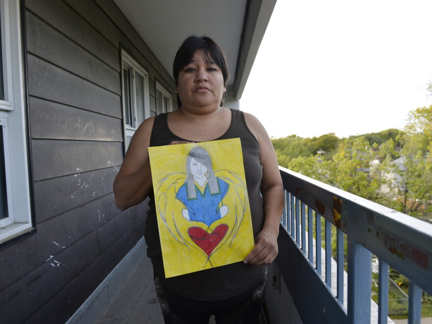 Lita Blacksmith displays a drawing she made of her 18-year-old daughter Lorna, who was murdered in Winnipeg in 2012. A police study found that 1 in 4 female homicide victims in Canada in 2012 was an aboriginal woman.