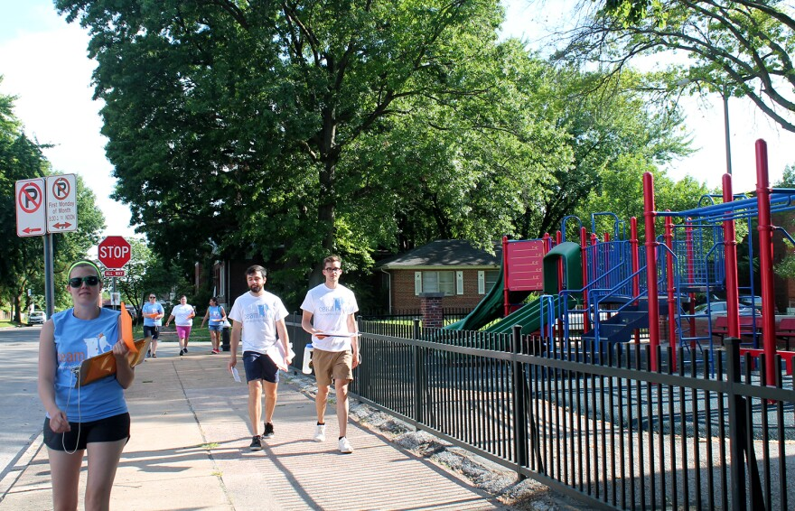 Gavin Schiffres and Jack Krewson, right, canvass the Dutchtown neighborhood with members of the school choice advocacy group Children Education Alliance of Missouri June 8, 2017. Schiffres and Krewson want to open a charter school in the neighborhood.