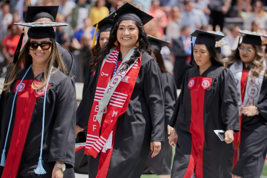 Alondra (center) recently graduated from Montclair State University. She's part of the record number of Hispanics going to college: Enrollment nearly tripled between 1999 and 2016.