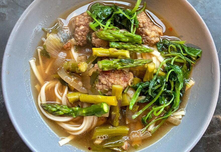 Spring miso broth with greens and ginger meatballs. (Kathy Gunst/Here & Now)