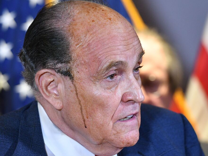 Trump's personal lawyer Rudy Giuliani perspires as he speaks during a press conference at the Republican National Committee headquarters on Nov. 19.