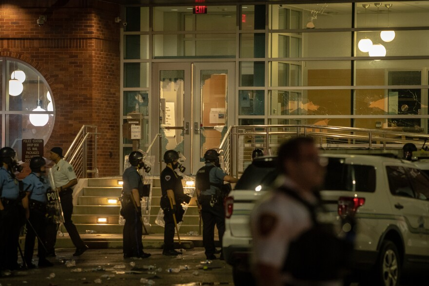 Protesters destroyed glass and spray-painted the Ferguson Police Department May 30, 2020. They later damaged other nearby buildings.