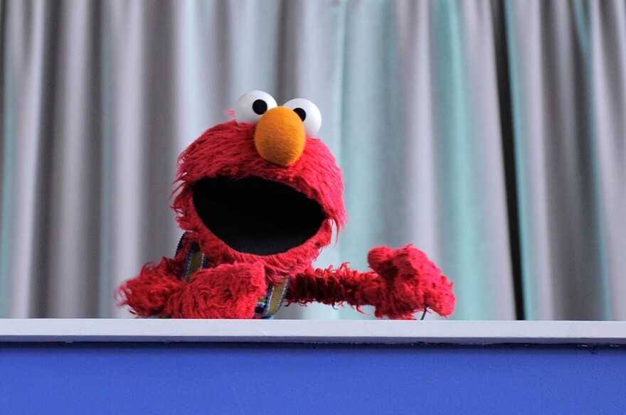 """Elmo addresses the crowd at the screening of """"Families Stand Together: Feeling Secure in Tough Times"""" in 2010."""