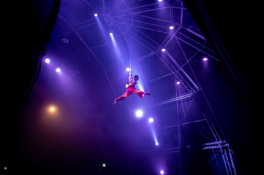 "Phelelani Ndakrokra performs an aerial acrobatic dance. Ndakrokra, who grew up in a part of Cape Town where gang violence is rife, says: ""The circus gave me a platform to feel free and do something I enjoy. It gave me a place to belong."""