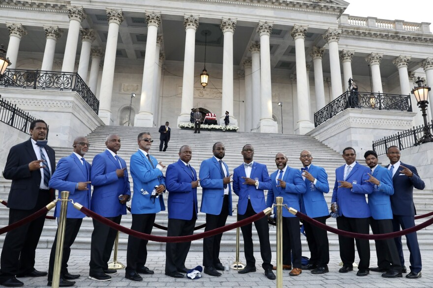 Members of Phi Beta Sigma, Rep Lewis' fraternity, hold hands and prepare to sing their fraternity's song. The members of the fraternity were from Fairfax, Va. and Montgomery County, Md.