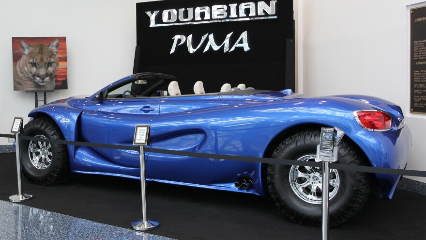 """The Youabian Puma, a 20-foot convertible that sits on 44-inch tires, has been panned by auto industry critics at the LA Auto Show. Some call it """"insane."""" Other say they hope it's just a joke."""