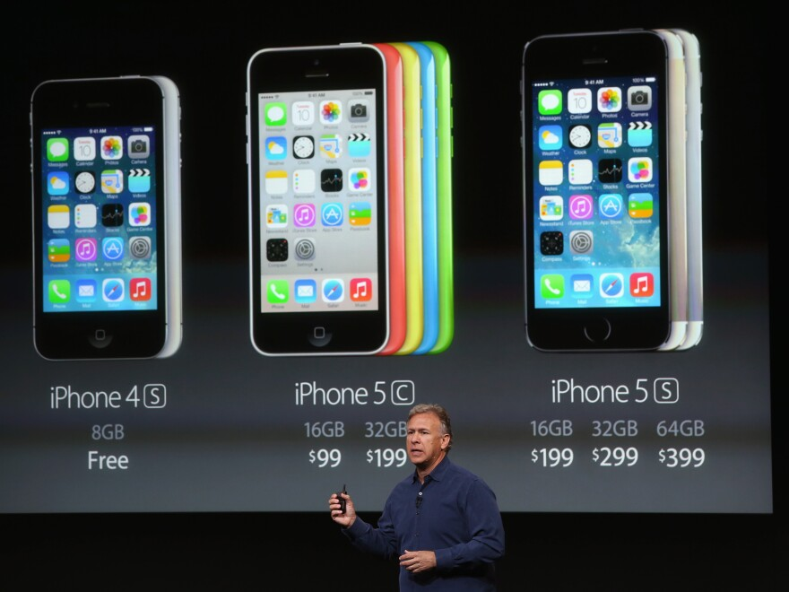 Phil Schiller, Apple's senior vice president of worldwide marketing, speaks about pricing for the new iPhone during an Apple product announcement on Tuesday.