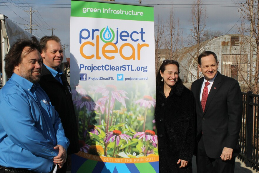 St. Louis Mayor Francis Slay and MSD Executive Director Brian Hoelscher pose for a photo at a press conference on Tuesday about the planned building demolitions.