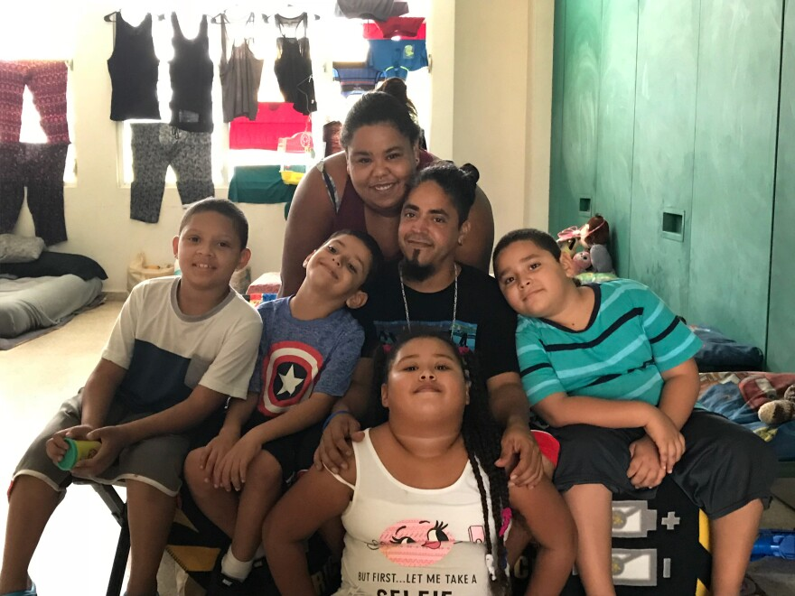 Chaylin Palma, her husband Miguel Nieves and their four children, (left to right) Johushua,  Abimael,  Chalyani and Miguel have been living in a shelter in a high school since their home was destroyed in Hurricane Maria.
