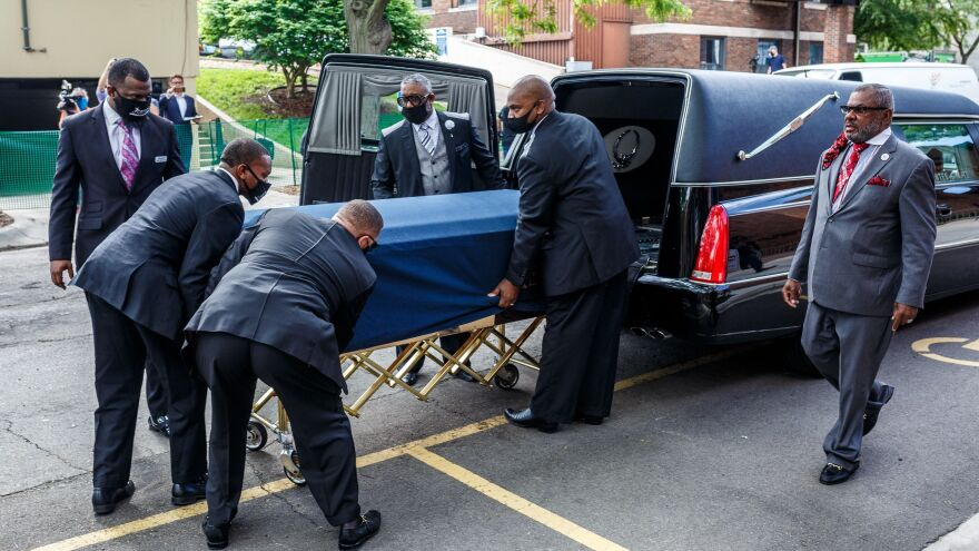 Floyd's remains are taken to the memorial service Thursday in Minneapolis.