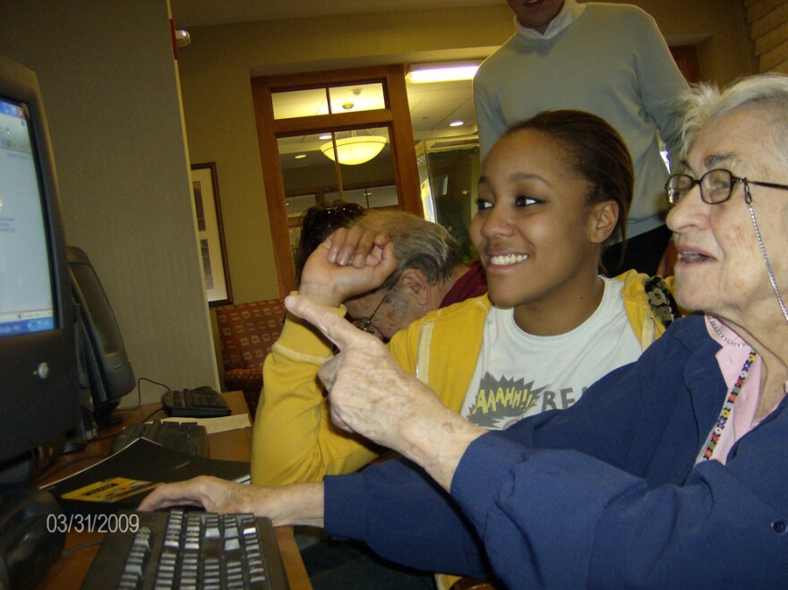 At Pace University in New York, college students who tutor seniors in local retirement homes are prepped with sensitivity training. Brittany Beckett (left), a Pace student, and Muriel Cohen work together at United Hebrew of New Rochelle.