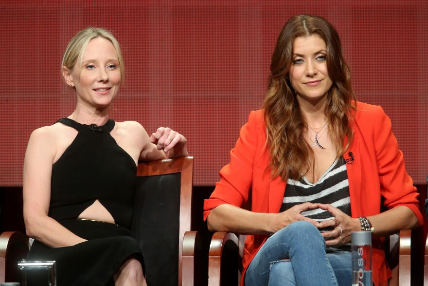 Executive producer Anne Heche (left) and actress Kate Walsh speak at the <em>Bad Judge</em> panel during the 2014 Summer Television Critics Association in Beverly Hills, Calif.