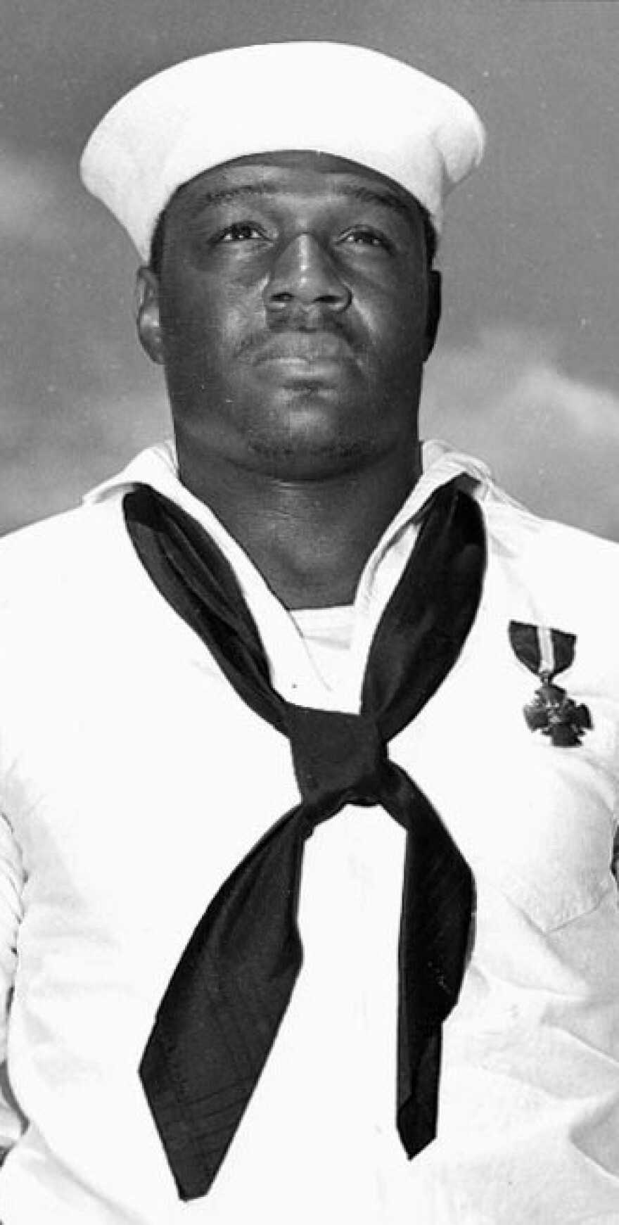 "Doris ""Dorie"" Miller, USN Mess Attendant Second Class, May 27, 1942 after presentation of the Navy Cross by Admiral Chester W. Nimitz aboard USS Enterprise."