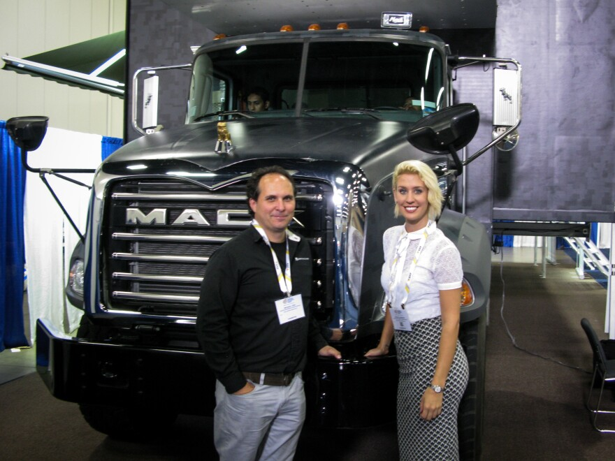 Mike Pine and Denise Germann of CT Defense at the expo with a $750,000 mobile command post they hope to sell to the U.S. Border Patrol.