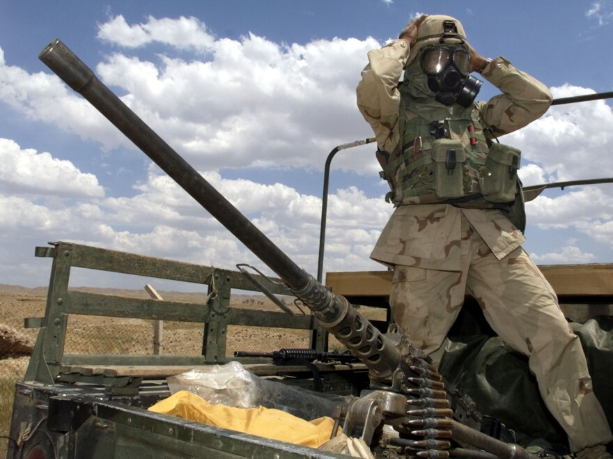 Soldier of U.S. Army 173rd Airborne Brigade prior to an air analysis mission near an oil and gas separation plant at the Baba Gurgur oil field outside northern Iraq's town of Kirkuk in May 2003.