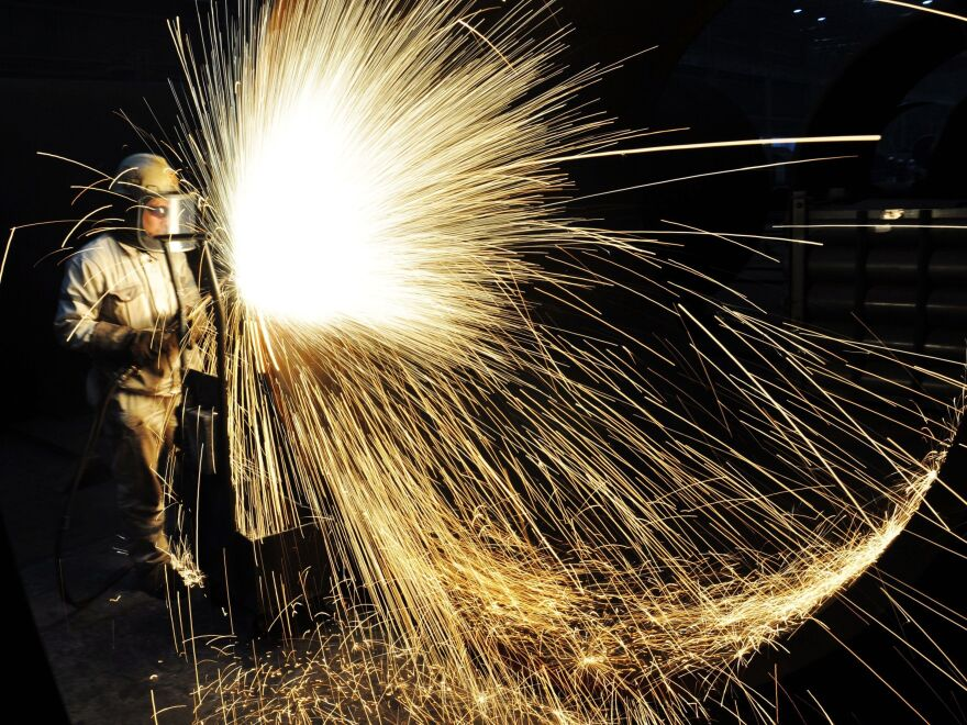 China has built one of the world's most formidable steel-producing sectors over the years. Above, a Chinese worker cuts steel in Qingdao in eastern Shandong province in January.
