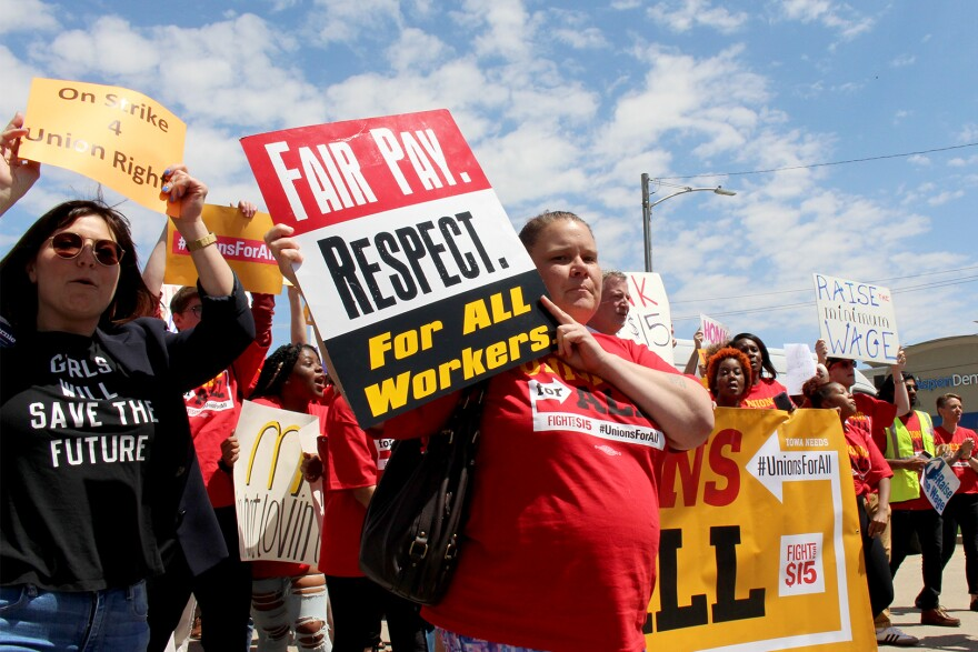 Fast food workers demonstrate for higher pay in Des Moines on May 23, 2019.