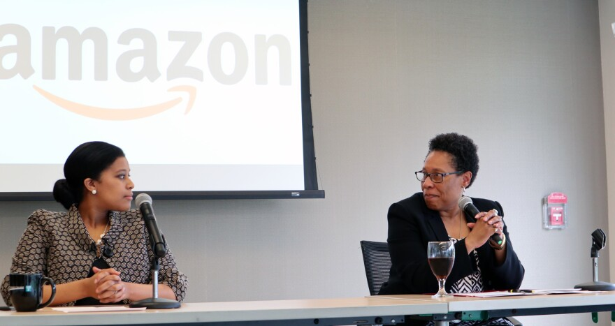 A photo of Nicole Jefferson (left), Manager of U.S. Public Policy for Amazon, and Ohio Congresswoman Marcia Fudge, discussing small business outreach at Tri-C's Corporate College East.