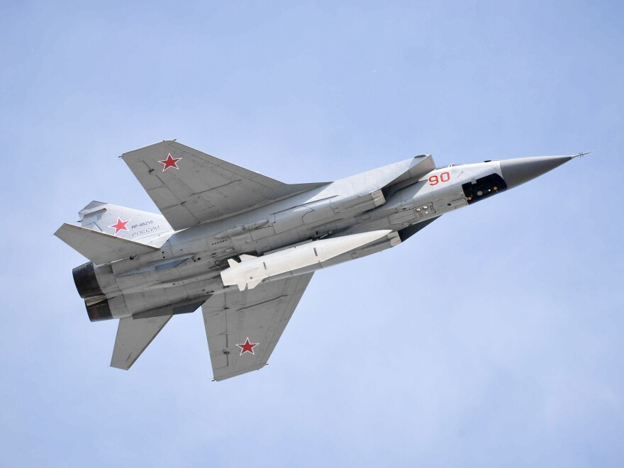 A Russian MiG-31K fighter jet with a hypersonic missile flies over Moscow's Red Square on May 9.