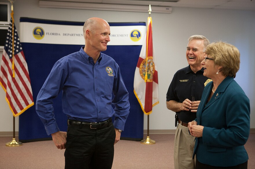 Happier times: Gov. Rick Scott seems relaxed on a visit to FDLE as Commissioner Gerald Bailey laughs in the background.