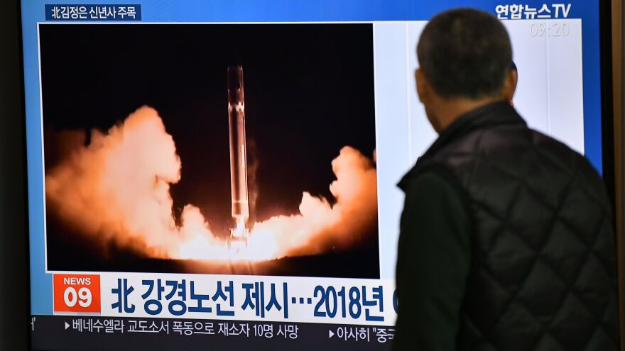 A man watches TV news at a railroad station on Jan. 1 in Seoul, South Korea. While waiting for North Korea's leader to address his nuclear-weapons plans, the program featured file footage of a North Korean missile test.