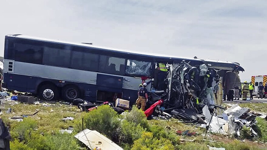 First responders work the scene of a collision between a Greyhound passenger bus and a semi-truck Thursday on Interstate 40 near the town of Thoreau, N.M., near the Arizona border. Multiple people were killed and others were seriously injured.