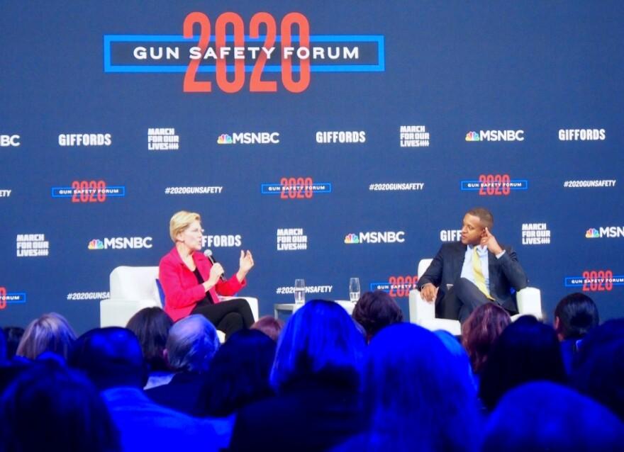 Massachusetts Sen. Elizabeth Warren speaks with MSNBC host Craig Melvin at a forum on gun issues for Democratic presidential candidates in Las Vegas on Wednesday, Oct. 2.