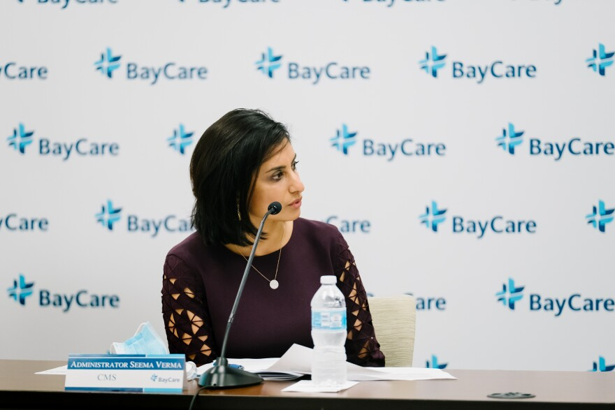CMS Administrator Seema Verma sits in front of a microphone at a BayCare Health System event
