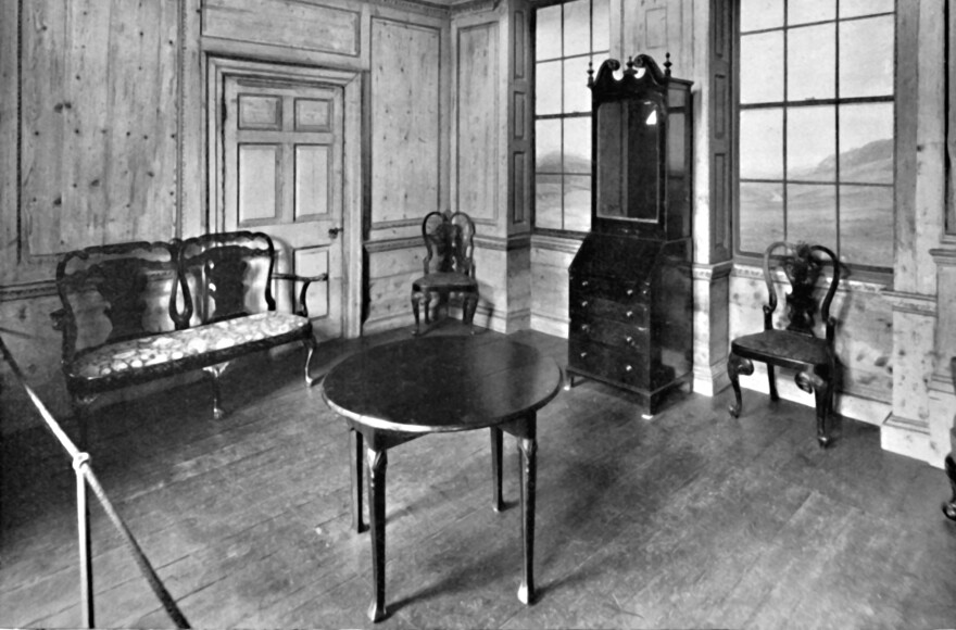 A paneled room, dated about 1740, containing furniture with the cabriole legs that are a hallmark of Queen Anne style. 1927. From Old Furniture, Volume I., edited by Lieut.-Col. E. F. Strange, C.B.E.