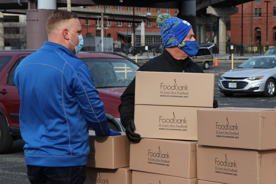 Volunteers and team members from the St. Louis Area Foodbank distributed meals in 10 different locations across the region  to help meet the increased demand for food on Tuesday. The organization distributed about 400 turkeys and holiday meal boxes in downtown St. Louis to families in need.